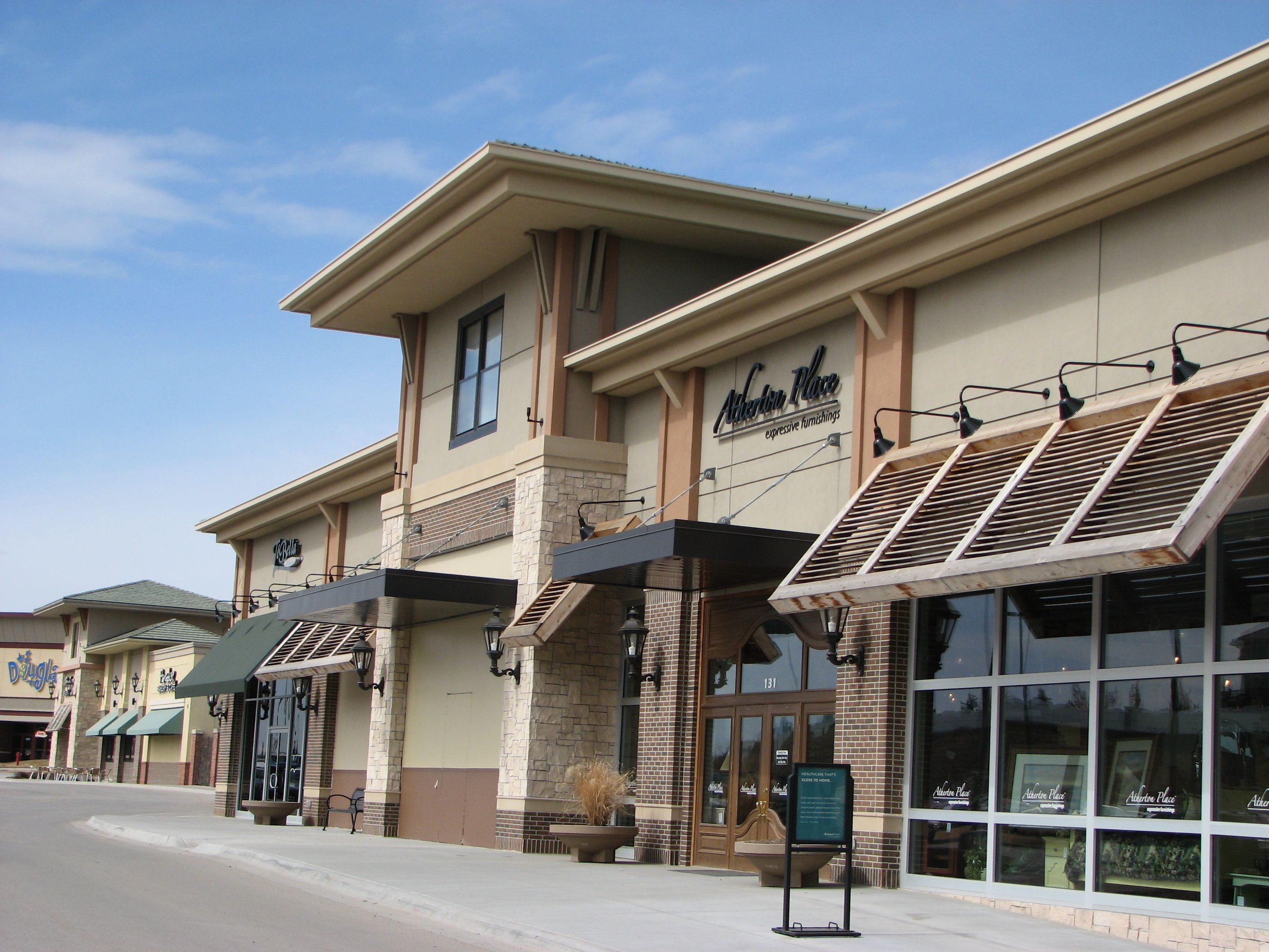 Exterior awnings commercial commercial awning ideas for Modern retail building design