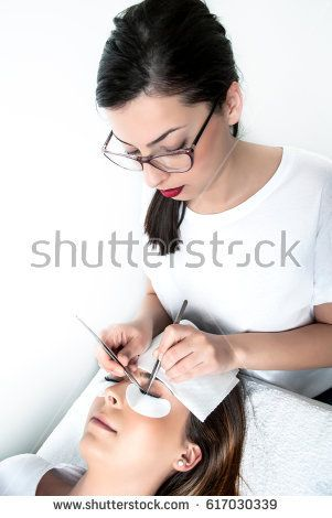 Beautician applying silk eyelashes in a beauty studio #shutterstock #photography #microstock #beauty