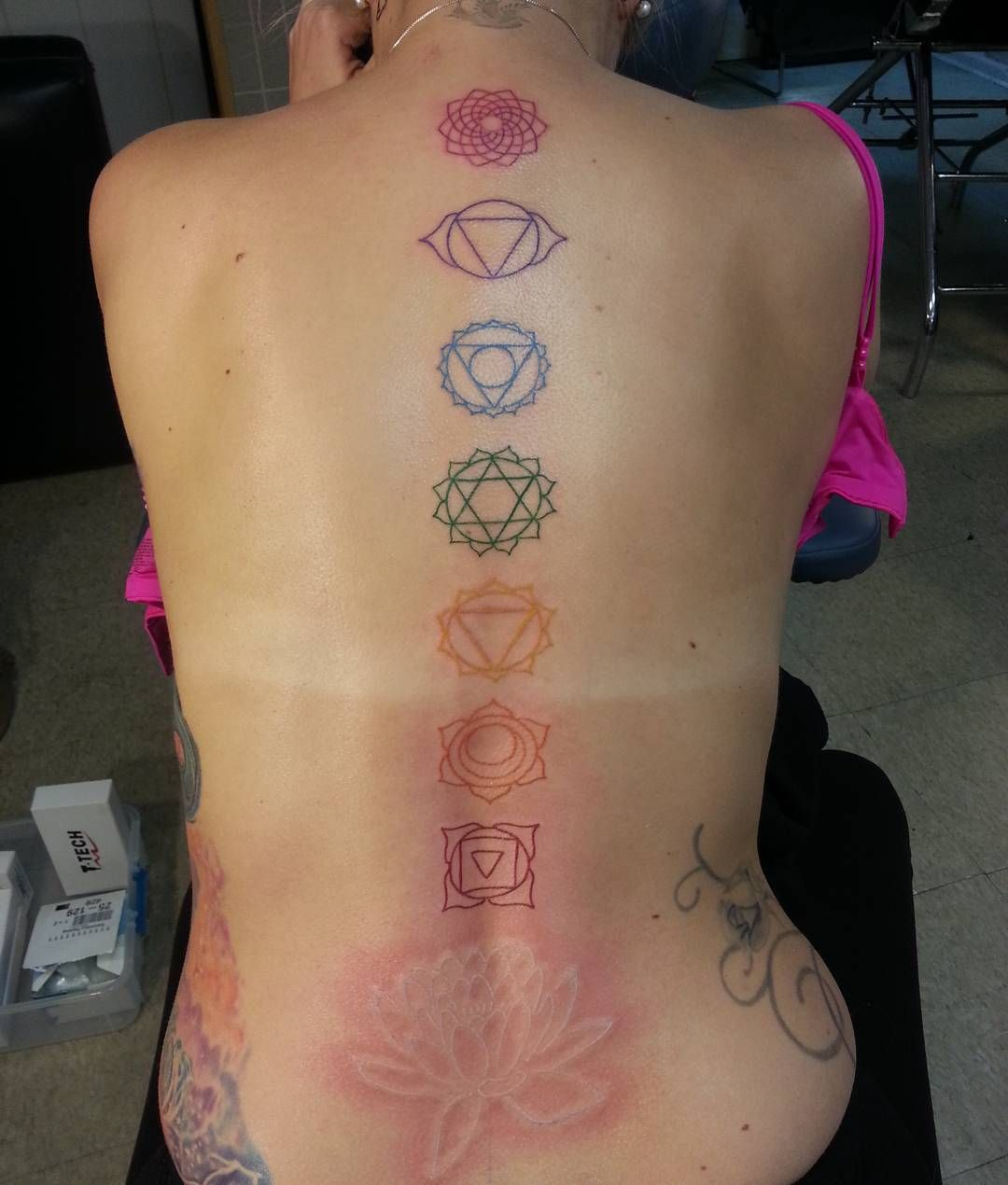 db24ecb9b5573 70 Latest Spine Tattoo Ideas for a Sexy Back Look. Multicoloured Designer  Chakra Tattoo on Spine