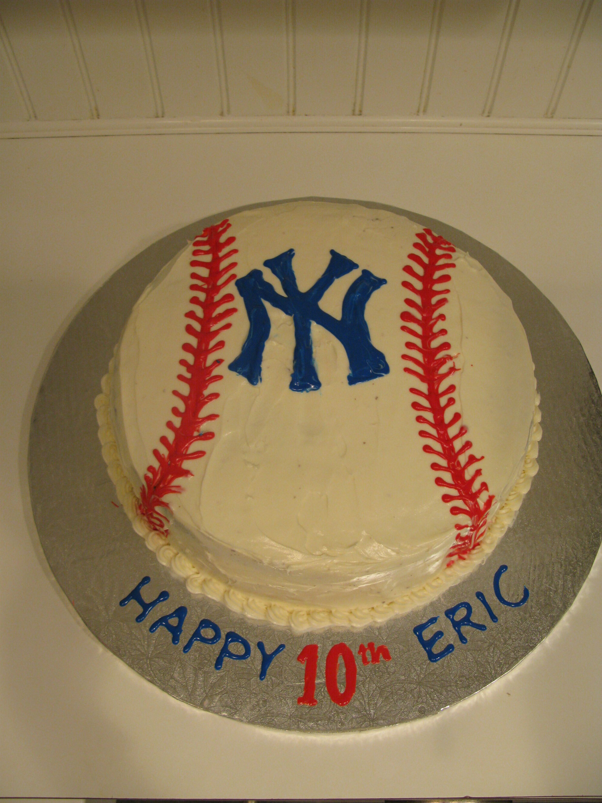NY Yankees Baseball Cake: I'm not thrilled with the stitching on the baseball. I think I put the stitches too close together.