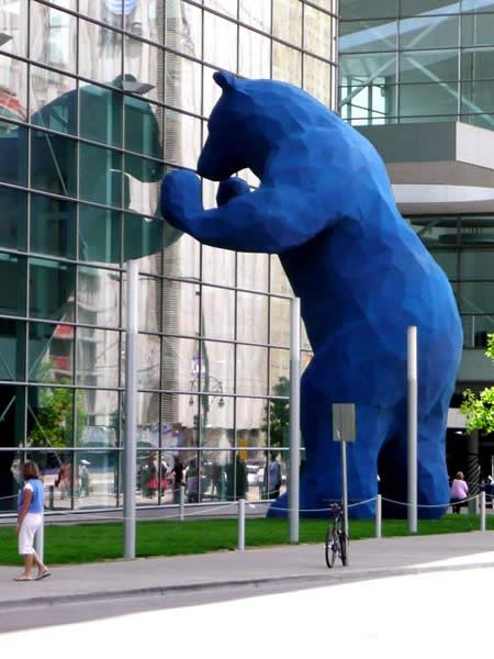 The big blue bear statue peaking in at the Colorado Convention Center in Denver.