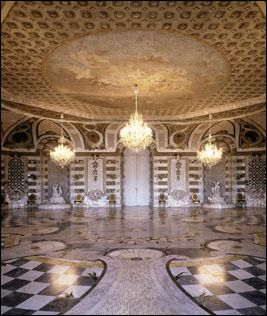 "This room is entirely covered in shells. It is inspired by the ""Rococo"" movement in art and fashion which is influenced by the curve of sea shells."