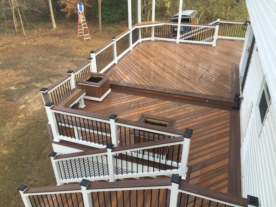 Fiberon Horizon Capped Composite Decking In Ipe With A Tudor Brown Border This Project Was Built By Mw Ente Outdoor Living Deck Composite Decking Fiberon