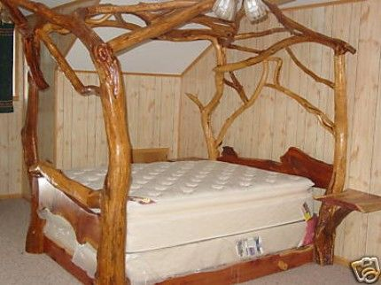 Cedar canopy bed. I love how it has bed side tables coming out ...