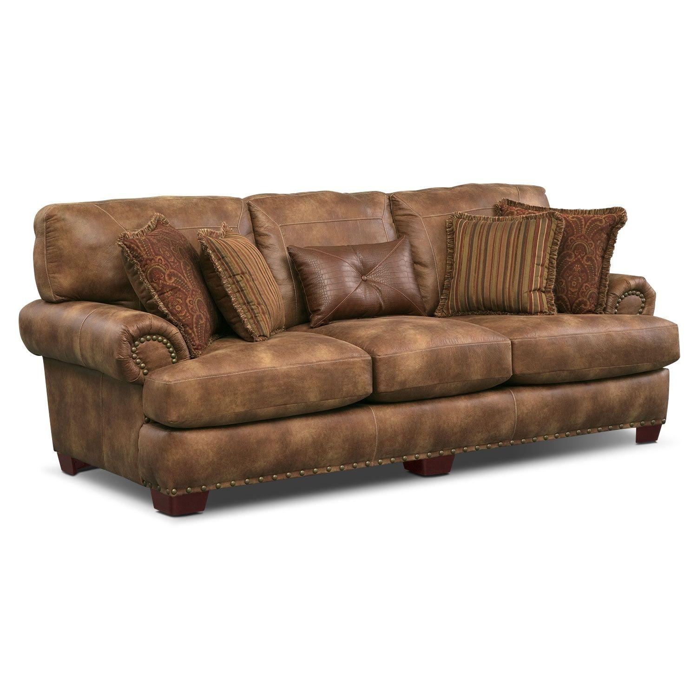 Lovely Gold Burnished Nailhead Trim Along The Cognac Colored Burlington Sofa Seems