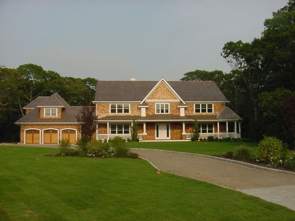 Traditional colonial home with 3 car garage excel homes for Modular 3 car garage
