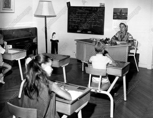 Original press photo from 1964 - Royal Road to Learning: School is in a palace, but like pupils everywhere, Princess Caroline and Prince Albert of Monaco must sweat out exams. The 7-year-old daughter and 6-year-old son of Prince Rainier and Princess Grace are tutored privately in a school held in the palace in Monte Carlo. Princess Caroline and Prince Albert at their desks in the classroom presided over by Mlle. Francine Vincent of Paris. <3
