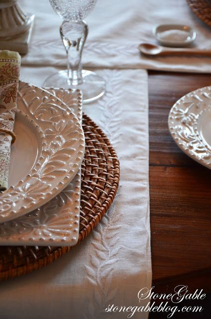 1. CHOOSE AN EASY FOUNDATION    My round kitchen table is set for four, but it could easily be set for six as well.  Because I want this table to have a relaxed feel I used two runners (Pottery Barn) instead of a table cloth. I don't have to iron them as I would a tablecloth.