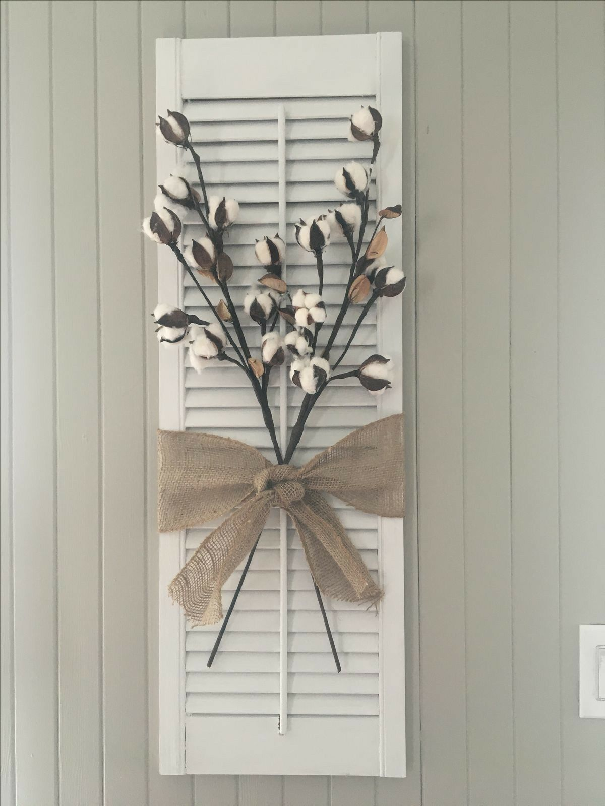 Painted Shutter With Cotton Stems And Burlap Bow.