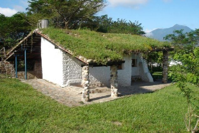 Plastic Homes From The Days When Plastic Was The Future Plastic Bottle House Bottle House Green Roof