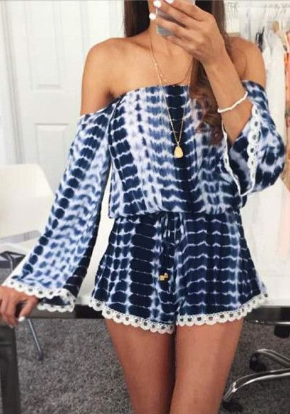 ff9b4a77b273 This blue tie-dye off shoulder romper features long sleeves and an off  shoulder neckline
