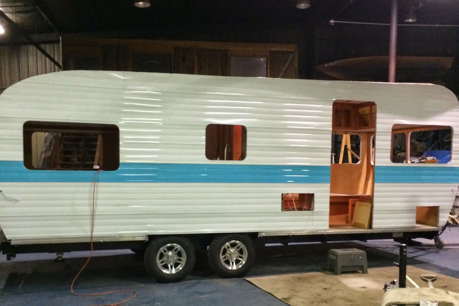 Our 24 canned ham style paradise coast rv is almost there pretty isnt she we had a custom aqua stripe done instead of the dove grey which is also