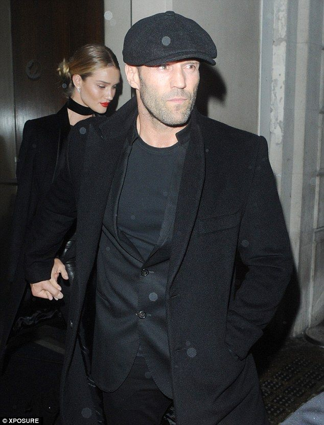 17a7fa31aa Jason looks rather dapper here in all black and a flat cap... Even if it is  hiding his disappearing hairline.