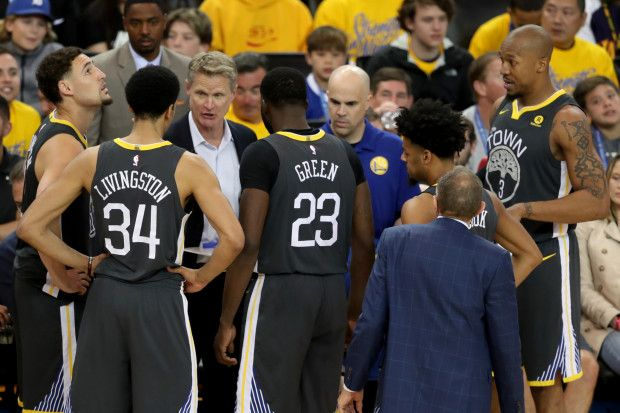 2e2f09b063c4 Golden State Warriors head coach Steve Kerr talks with his players during a  timeout in the