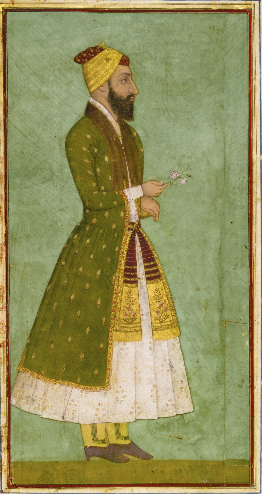 Portrait of a Nobleman, gouache heightened with gold on paper, Mughal Period, C. 1670, India. The gouache depicting a bearded figure in green and white robes with a floral patka, holding a flower in his right hand, red and gold turban, laid down on an album page with leafy floral borders with applied floral cartouches in different colours, the reverse with a text block with 14 lines of elegant nasta'liq script in black ink, with a heading panel left blank but with floral decoration.