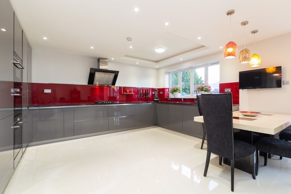 Large U Shaped Kitchen Design In A Handleless Grey High Gloss Lacquer  Finish.
