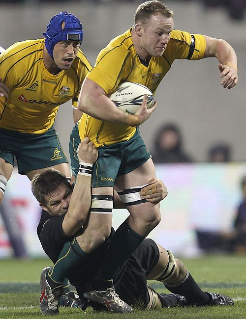 All Blacks Captain Richie Mccaw Tackles Richard Brown Of The Wallabies