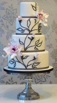 Beautiful and organic magnolia design.  Grey and pink wedding cake