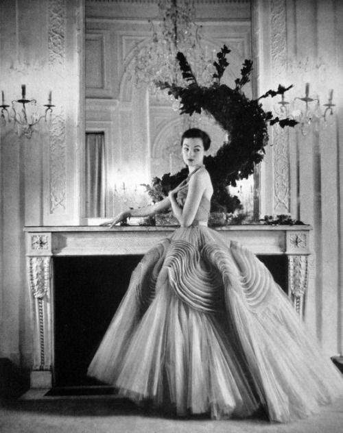 Model wearing an evening gown for Queen magazine, 1951