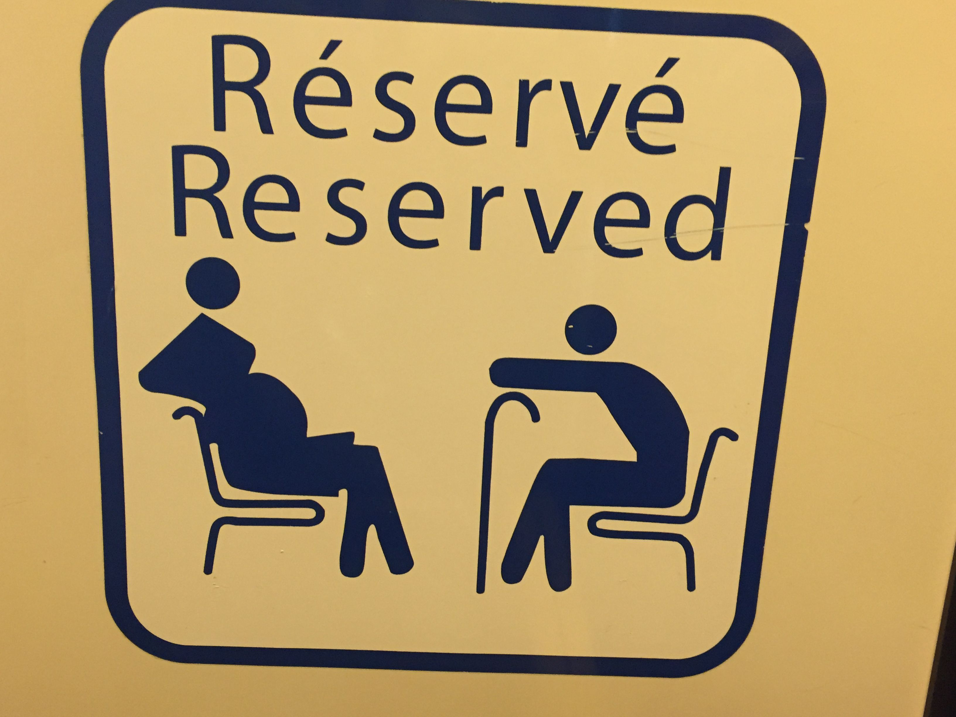 Reserved for pregnant women & people who have hurt their back?  OR people with canes...