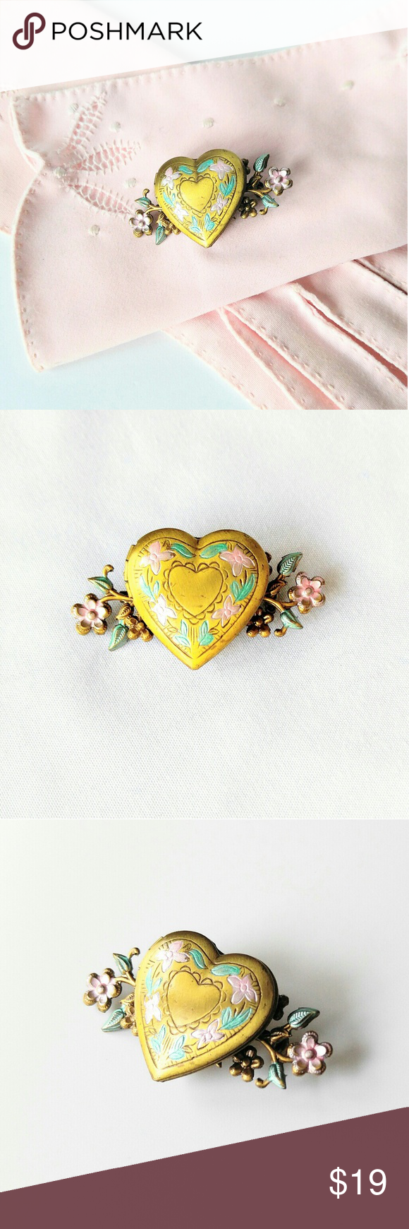"""RARE VINTAGE Heart Locket Brooch-Painted Flowers How lovely this is!  Brass toned with painted flowers and leaves vintage locket brooch.  Just precious! Good vintage condition, but there are a few scuffs to the brass on the locket.  It closes and opens nicely. This piece measures about 2 x 1-1/8"""".  Add as many items to your order as you like.  The shipping stays the same.  PickinChick sells in other online areas, as well as owning a storefront. Vintage Jewelry Brooches"""