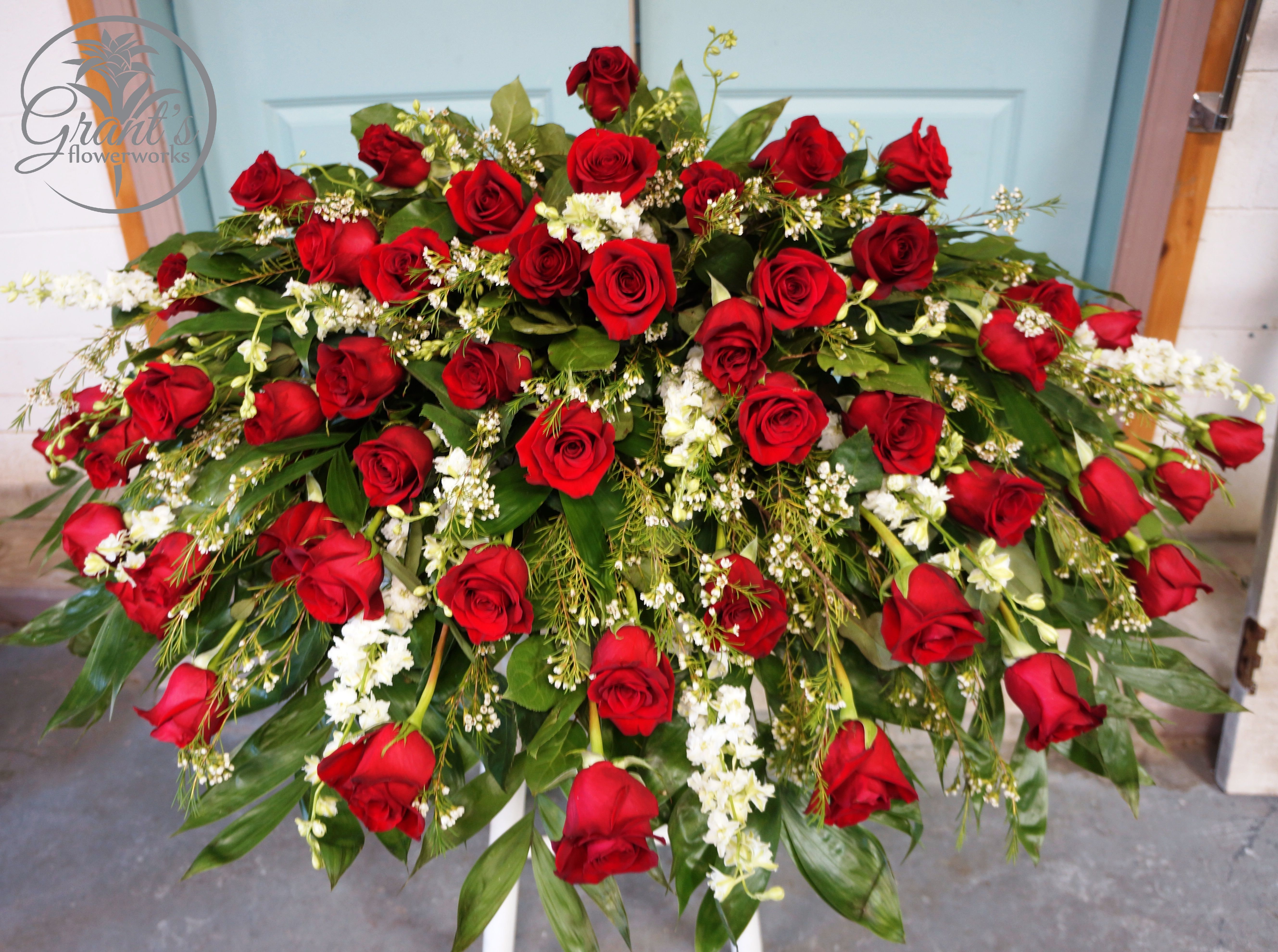 Casket spray by grants flowerworks home going floral someone has order classic red white casket spray flower arrangement from grants flowerworks your local port allen la florist send classic red white casket spray izmirmasajfo Choice Image