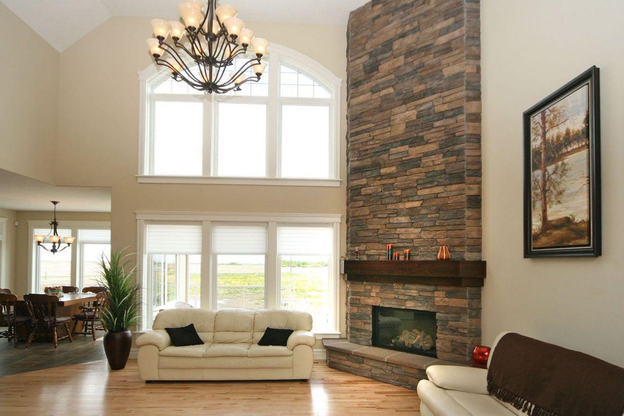 Large Floor To Ceiling Stone Fireplace Light Hardwood Floors
