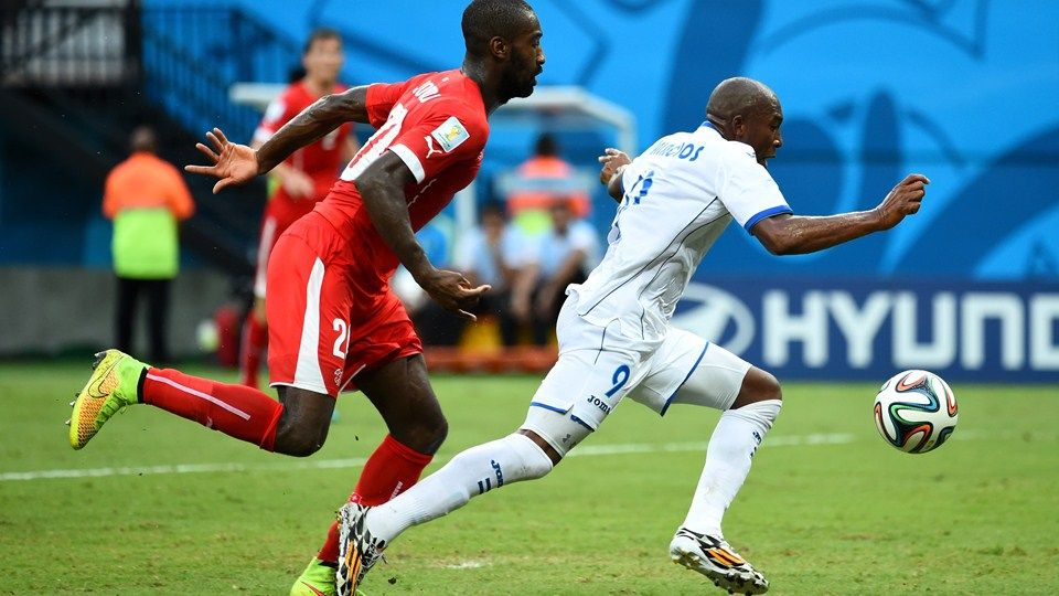 e174a257008 Johan Djourou of Switzerland and Jerry Palacios of Honduras compete for the  ball