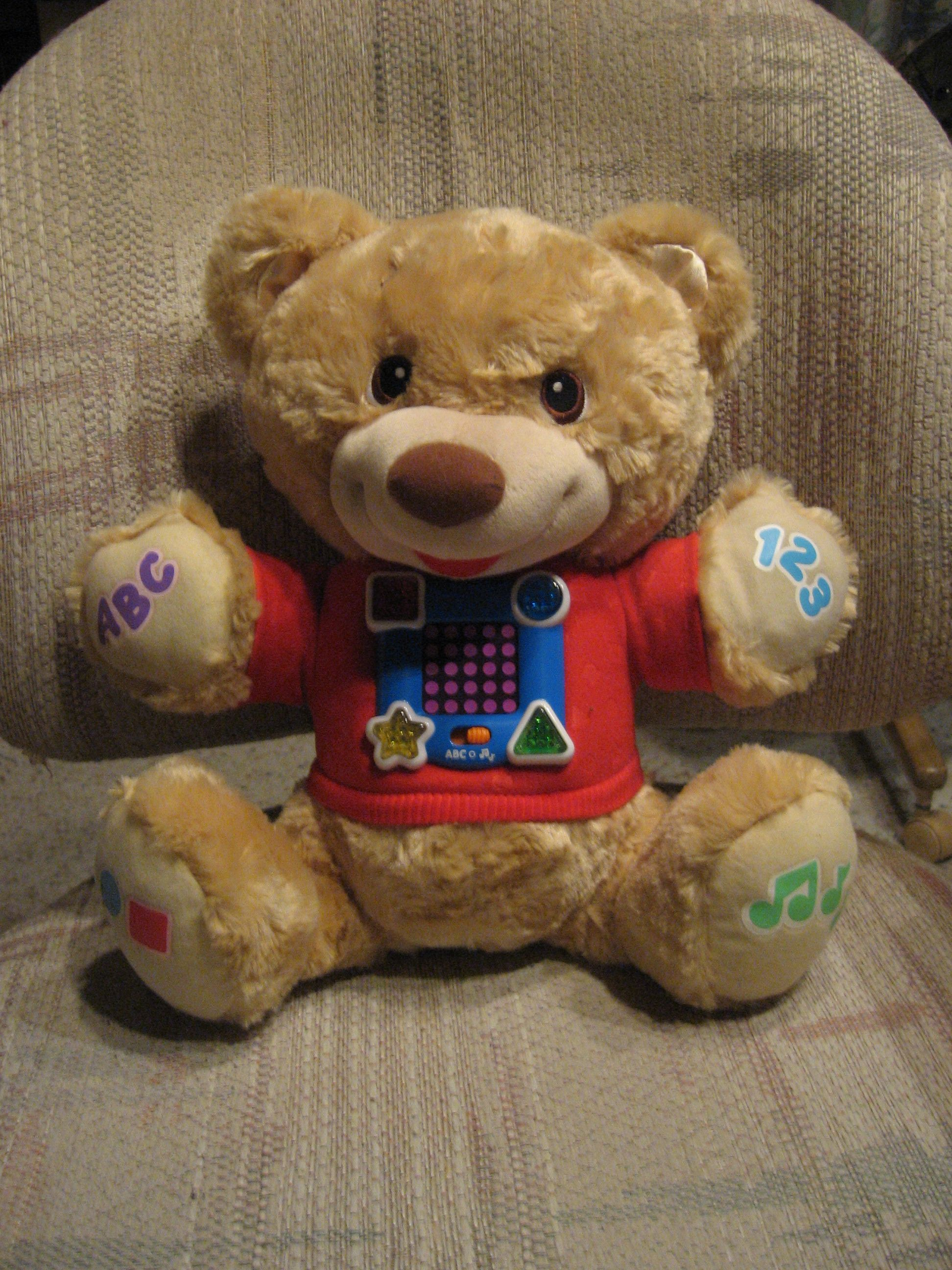 This is a Bear Plush by Fisher Price that sings, talks, says the alphabet, counts numbers, says and shows colors and shapes! I got it for my friend, Mark's great-nephew, Winnie!