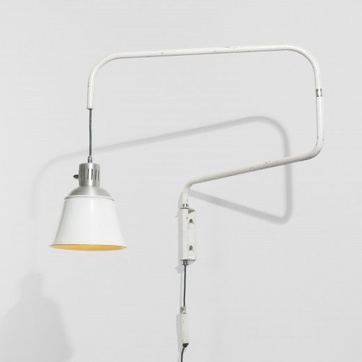 The height and depth of this lamp are adjustable; the lamp measures 48-inches from the wall when fully extended.