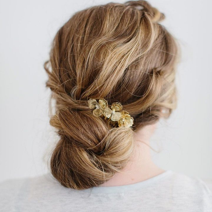 modern bun wedding hairstyle for modern brides #updoartist #modernsalon #behindthechair #upstyle #longhairstyles #bridetobe #lowbun #messybun