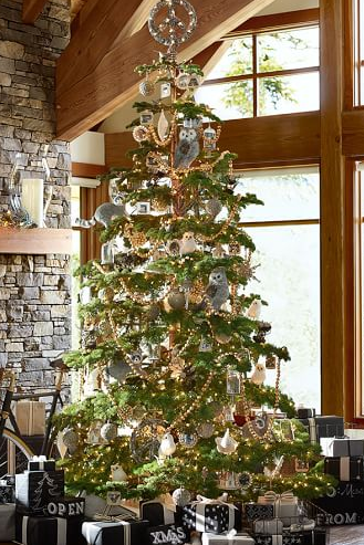luxe lodge christmas tree with owls glass gold bead garlands pine cones and beautiful glass ornaments