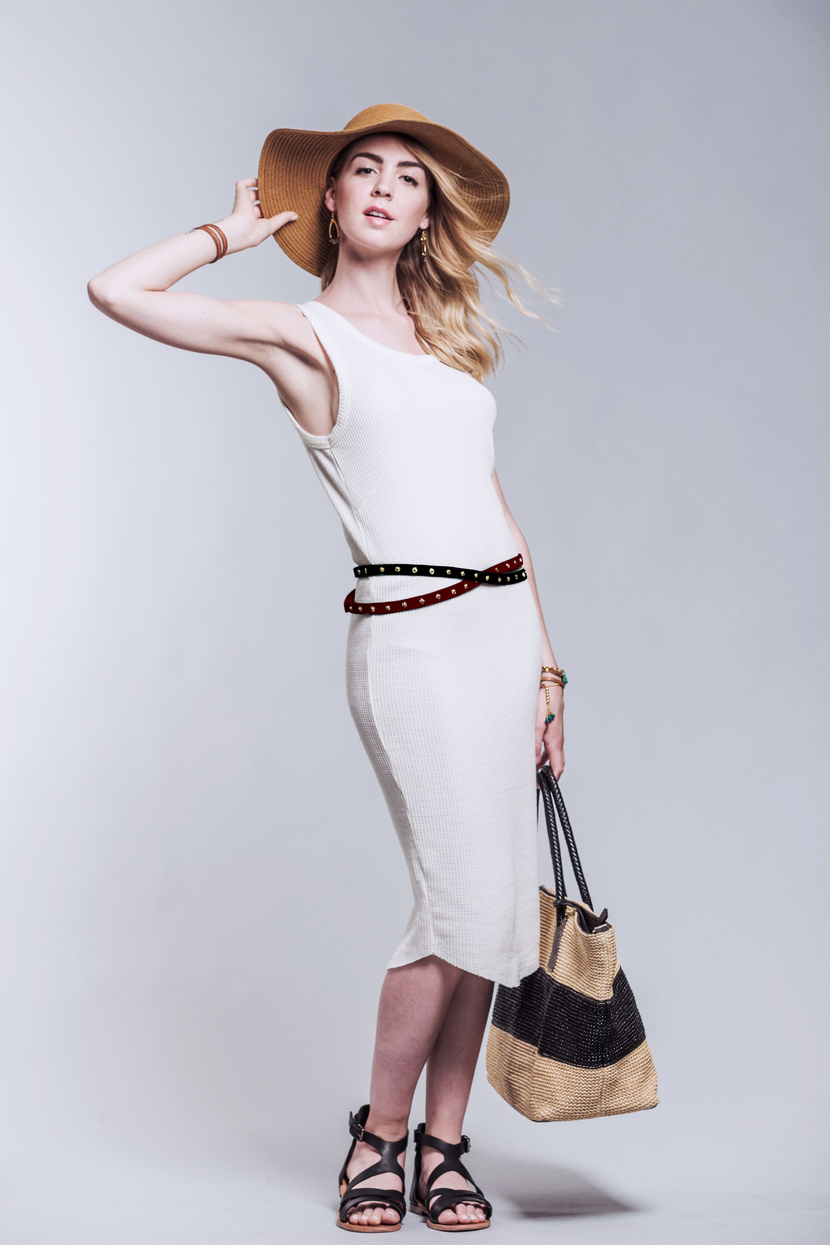 White tunic dress with leather belt