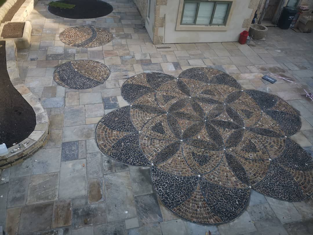 The Flower Of Life Cobble And Pebble Mosaic Finished Happy Day Www Wildeartthworks Com Stone Cobbles Gardendesig Pebble Mosaic Flower Of Life Stone Mosaic