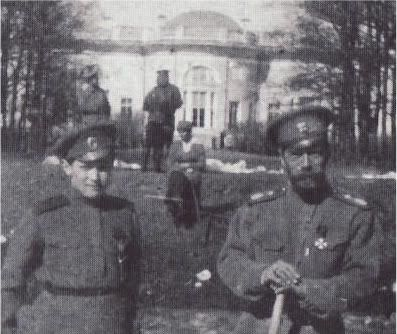 Alexei and Nicholas in captivity in Tsarkoye Selo 1917, behind them sits one of the grand duchesses