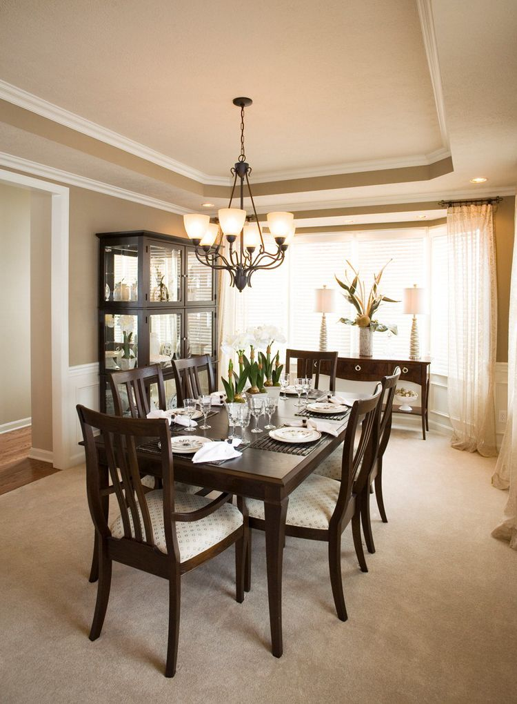 Formal dining room with large windows