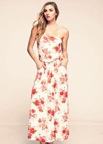 52c42ca830 Vestido largo blanco palabra de honor estampado con flores rojas ...