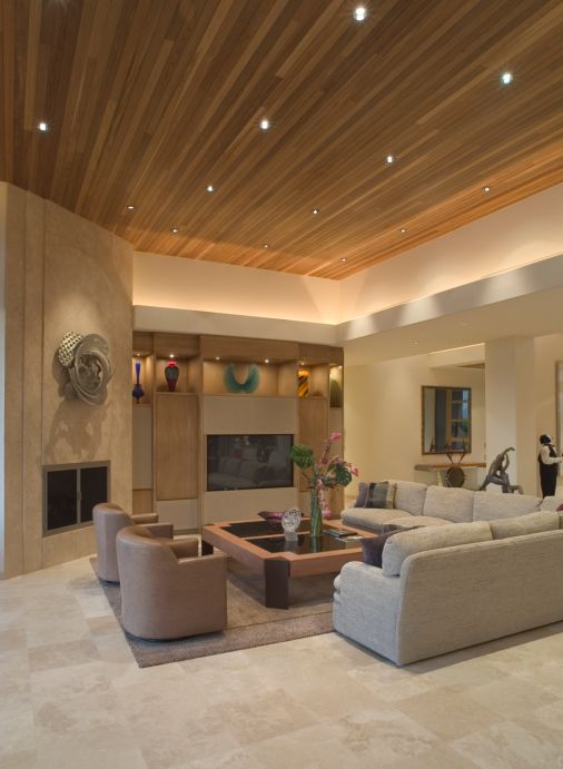 Large Living Room In Beige Color Scheme With Elevated Wood Ceiling.   Tile  Flooring