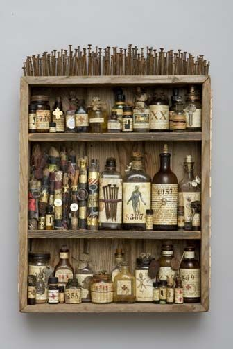 "Medicine Cabinet Mar Goman wooden box, altered bottles, found objects, scrolls, nails, mixed media, 2009 24 x 17 x 5"" 77-329"