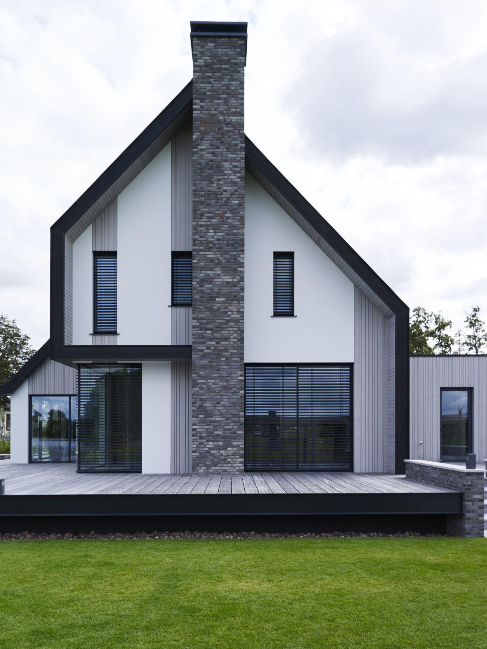 Een nieuwe villa aan het water stucwerk cederhout for Moderne semi bungalow bouwen