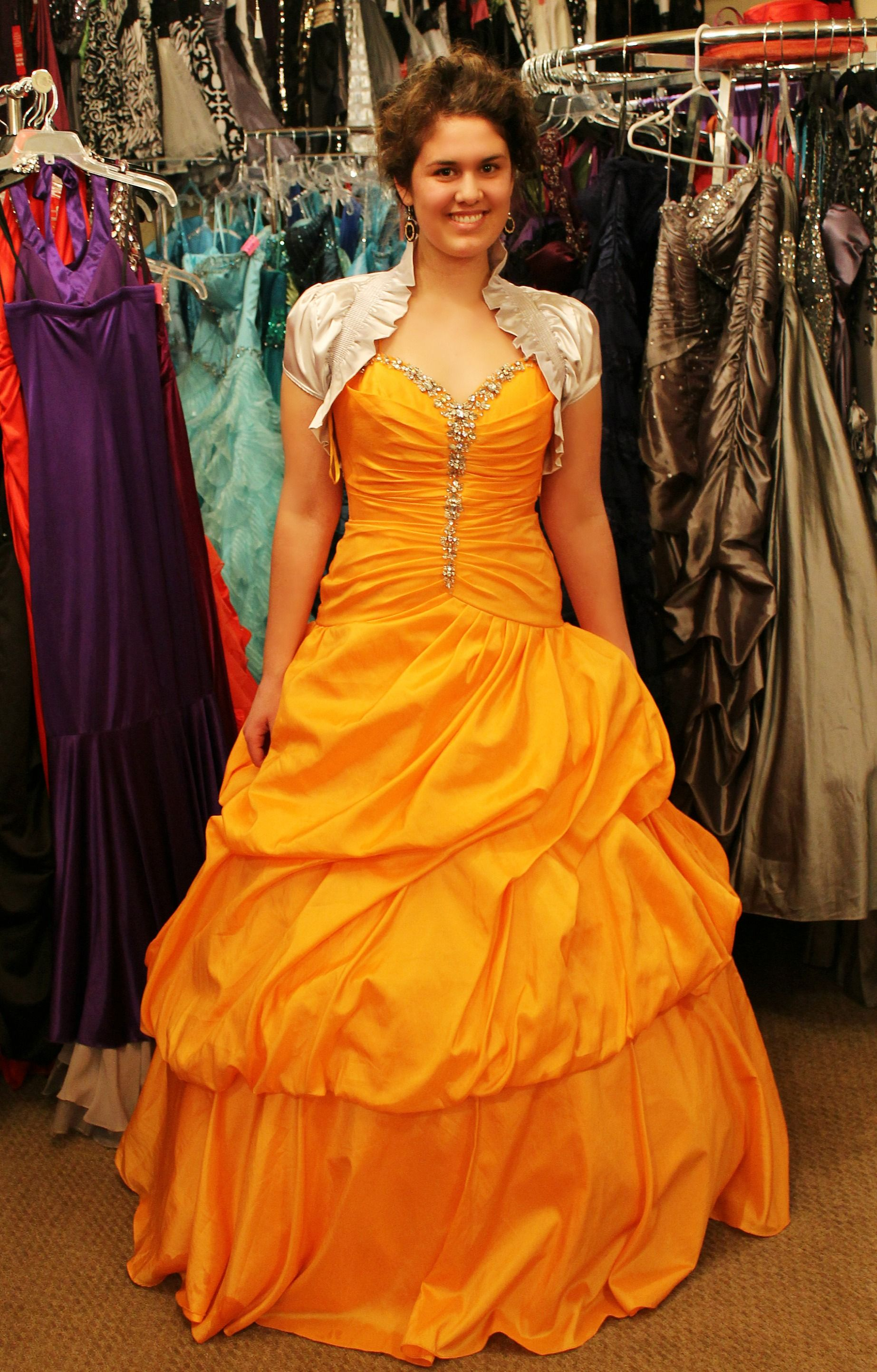 Orange ball gown formal prom dress! Available for rent at Dazzling ...