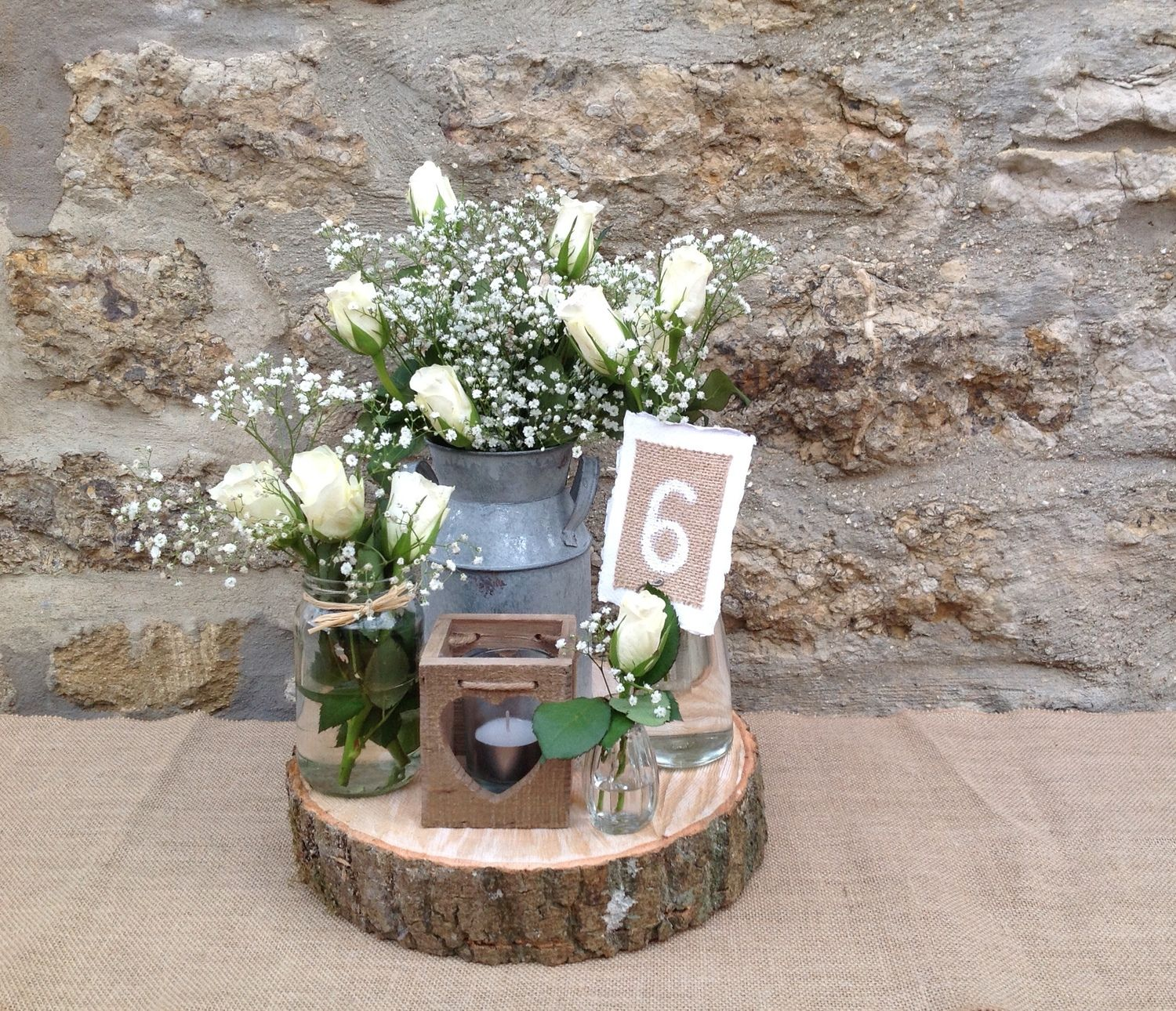 Rustic wedding decorations wood slices tea light holders for Milk can table ideas