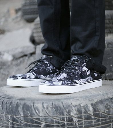 Elevating the classic Janoski upper with the addition of a striking  pattern, the Nike SB
