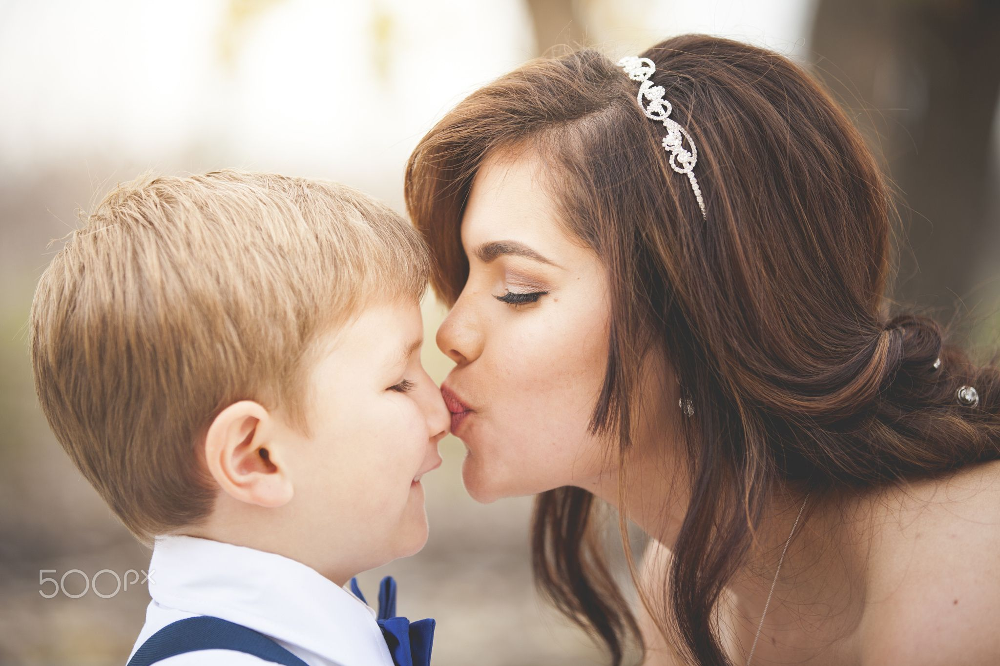 Kiss On The Nose A Young Bride Giving A Kiss On The Nose To A