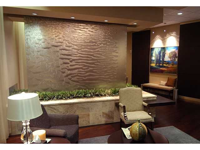 Earth Tones Sage Taupe Gray Brown Water Feature Plants Artwork In A Waiting Area