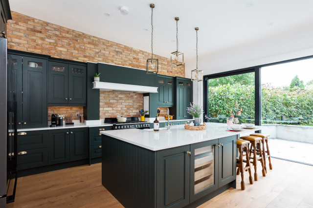 Dark Green Cabinets Add Elegance To A Welcoming Kitchen Modern Country Kitchens Cottage Kitchen Design Dark Green Kitchen