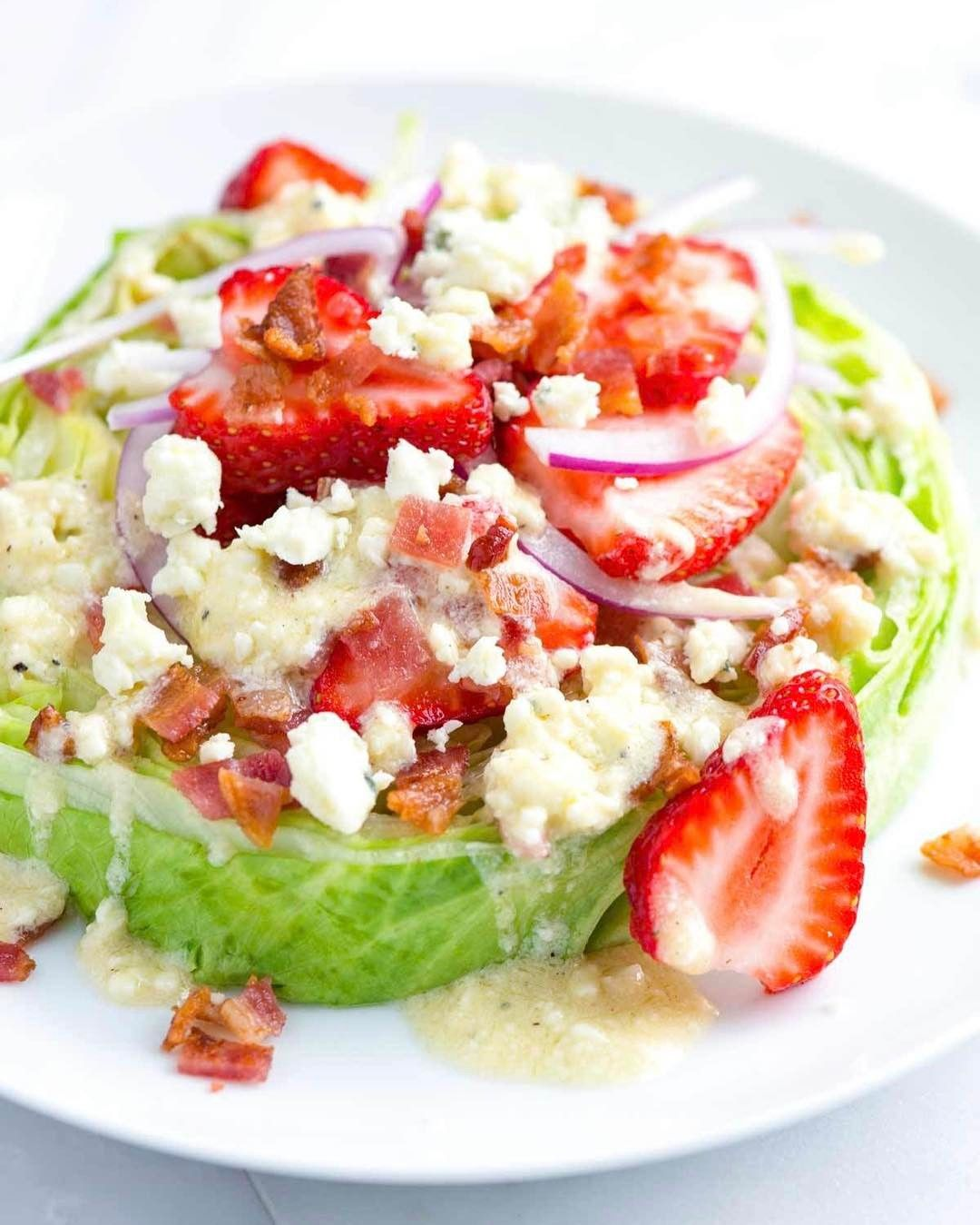Strawberry Iceberg Salad with Blue Cheese Vinaigrette 🍓 🍓 🍓  Iceberg lettuce sometimes gets a bad rap, but it is perfect in this salad! Click @inspiredtaste for a link to the recipe! ⠀ ⠀ ❤️ If you make this recipe, snap a photo and share it with us. hashtag it #inspiredtaste -- We love seeing your creations - A&J