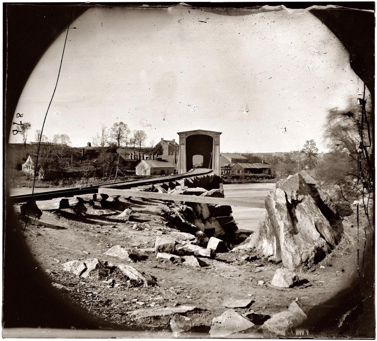 Spring 1865. Belle Isle railroad bridge from the south bank of the James River after the fall of Richmond. Glass plate negative from the Civil War collection compiled by Hirst D. Milhollen and Donald H. Mugridge.