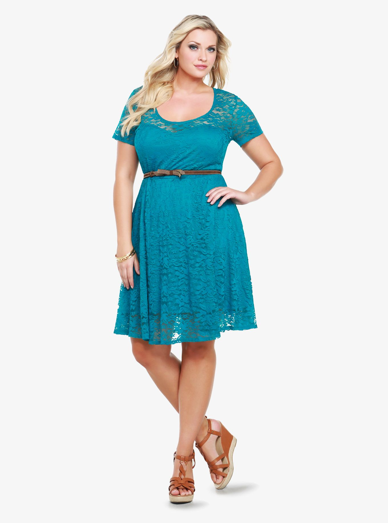 Wedding dresses for full figures  Covered in floral lace this teal dress has a sweetheart neckline