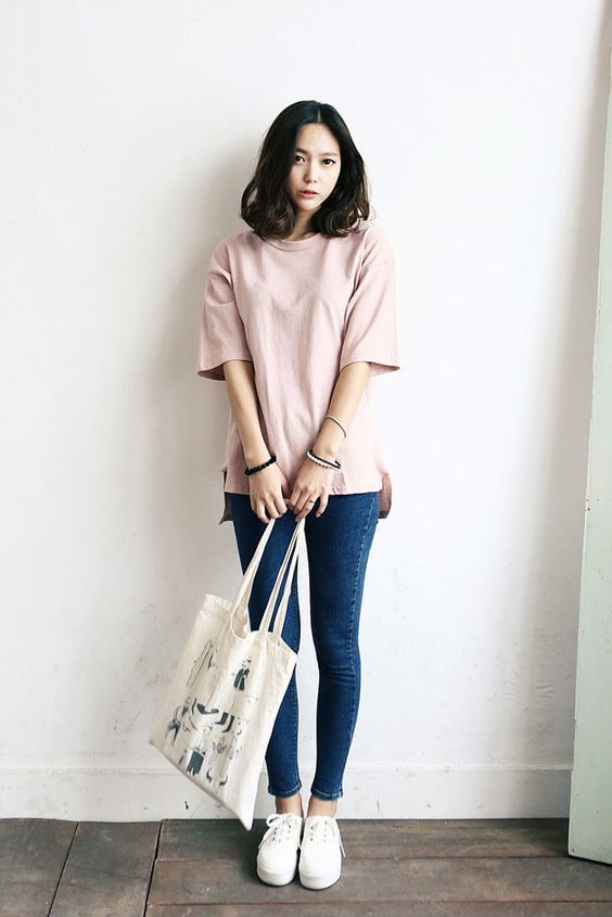 Pink shirt, blue jeans, white shoes. Hair. Tote